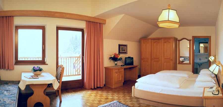 Italy_The-Dolomites-Ski-Area_Ortisei_hotel_dolomiti_madona_bedroom.jpg